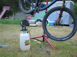 No, not to disinfect me! This is a brilliant way to wash your bike at a race.